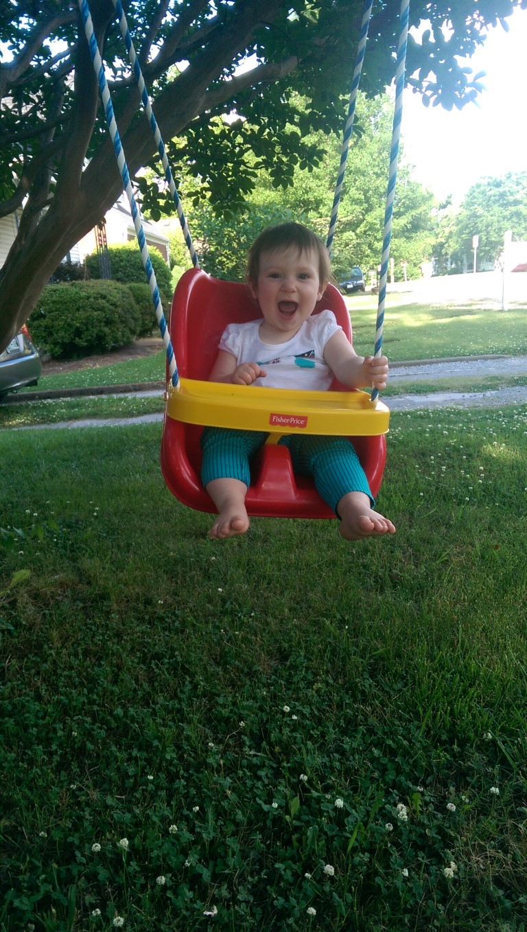 Maggie on the Fisher-Price Infant to Toddler Swing